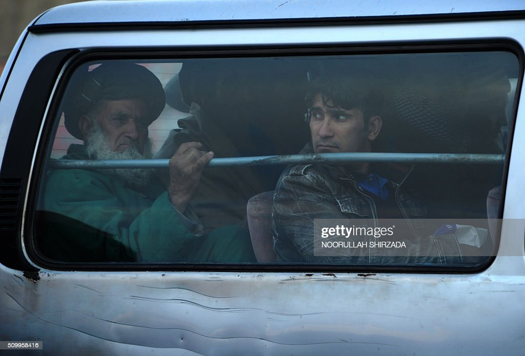 Afghan passengers look through a car window in the Old City of Kabul on February 13, 2016. AFP PHOTO / Noorullah Shirzada / AFP / Noorullah Shirzada