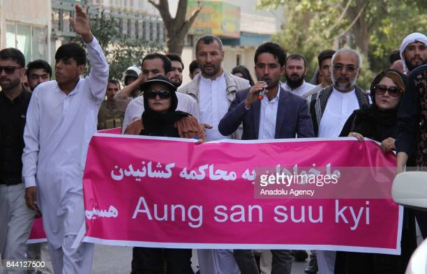 Afghan people and activists shout slogans as they hold a banner during a protest against Myanmar's oppression towards Rohingya Muslims in front of...