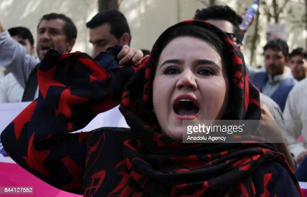 Afghan people and activists shout slogans during a protest against Myanmar's oppression towards Rohingya Muslims in front of the United Nations'...