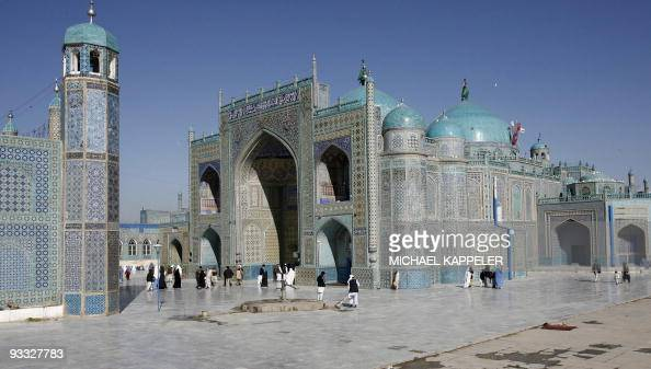 Afghan people walk in front of the shrine of HazratiAli also called the Blue Mosque in MazariSharif the capital of Balkh province north of Kabul 05...