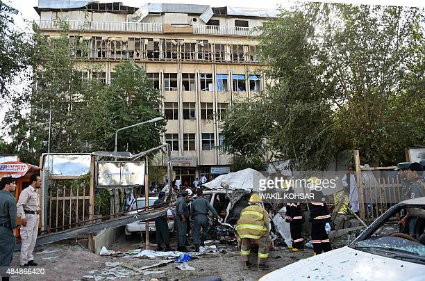 Afghan police and security forces inspect the site of a car bomb in Kabul on August 22 2015 A suicide car bomb apparently targeting a foreign forces...