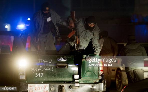 Afghan police arrive at the scene of an explosion in Kabul on January 17 2014 A large explosion followed by sporadic gunfire rocked central Kabul in...