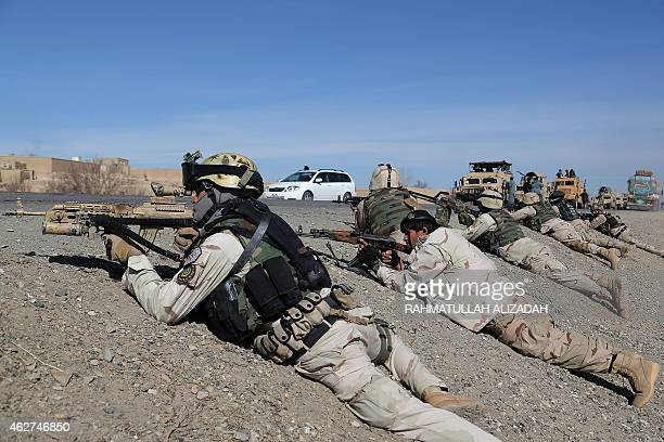 Afghan police forces participate in an antiTaliban operation in the Andar district of Ghazni province on February 4 2015 Afghan police forces...