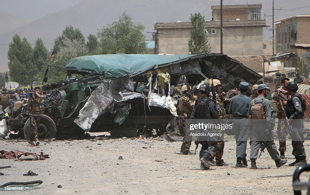 Afghan police inspect the explosion site in in Kabul, Afghanistan on June 30, 2016. The buses carrying police cadets were targeted as they were on their way from the neighboring Maidan Wardak province to Kabul. According to the preliminary reports, at least 30 policemen have lost their lives and dozens of others injuries.