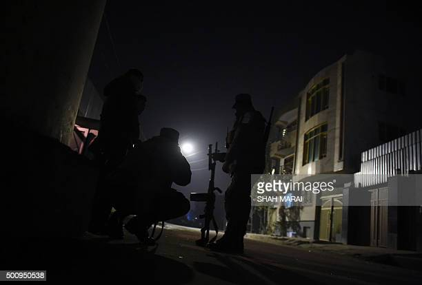 Afghan police keep watch at the site of an attack on the Spanish embassy compound in Kabul on December 11 2015 Insurgents have launched an attack on...