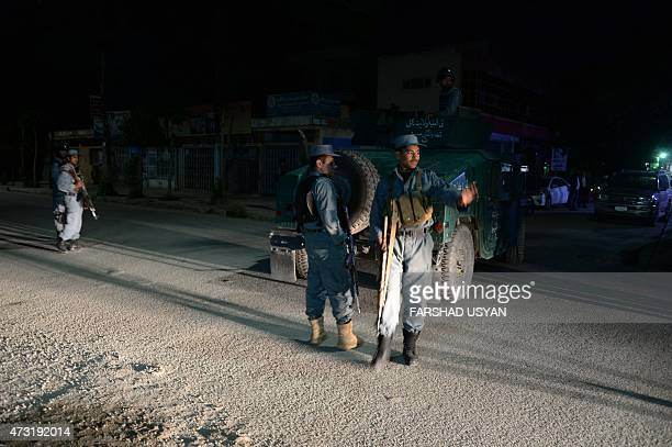 Afghan police officers stand gaurd near the Park Place guesthouse in Kabul early on May 14 2015 Gunmen stormed a Kabul guesthouse popular with...