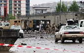 Afghan policemen and officials work at the site of the Taliban attack in front of Afghan intelligence office in Kabul Afghanistan on April 19 2016 At...