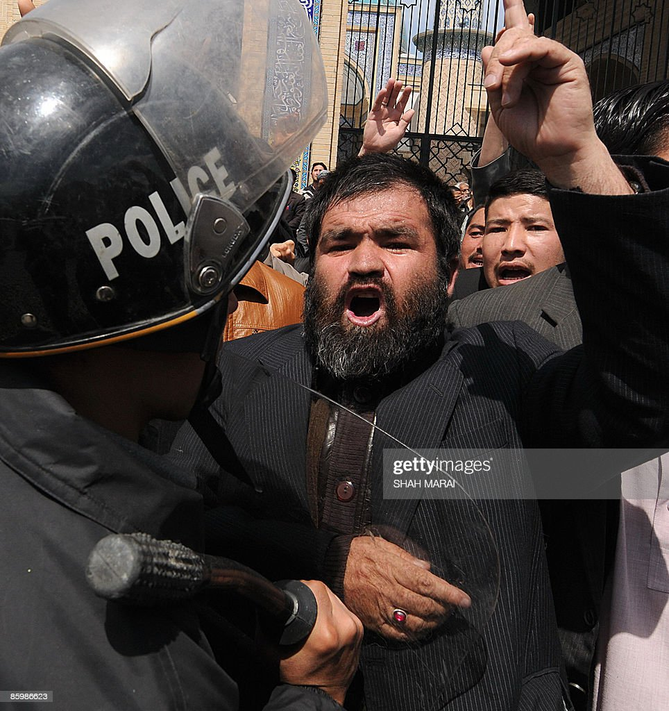 afghan policemen control angry shiite mu pictures getty images afghan policemen control angry shiite muslims defending the new shiite personal status law in kabul on
