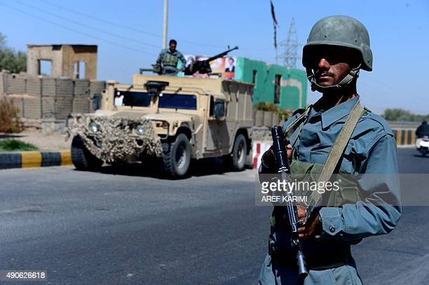 Afghan policemen keep watch at a checkpoint in Herat on September 30 2015 AFP PHOTO / Aref Karimi