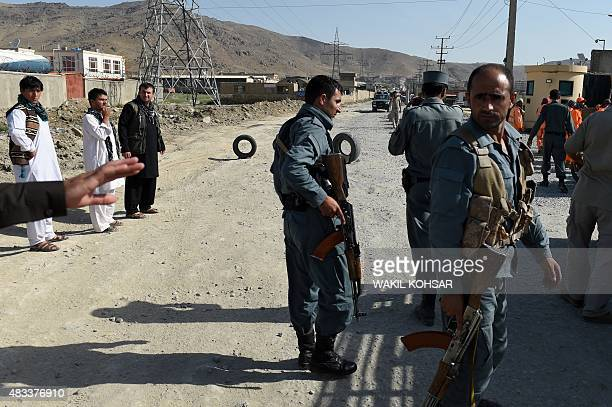 Afghan policemen keep watch near Camp Integrity a base housing US special forces that was attacked by militants in Kabul on August 8 2015 The attack...