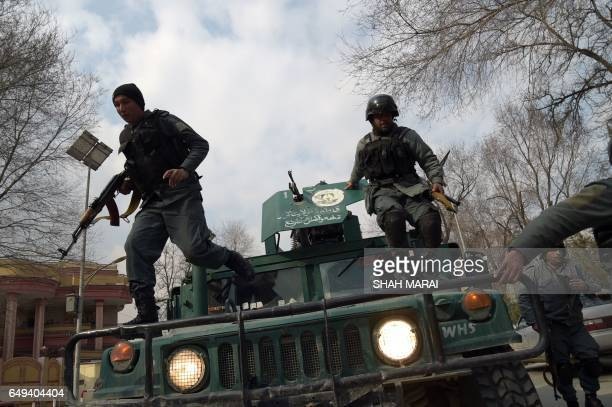 TOPSHOT Afghan policemen leap from a vehicle as they arrive at the site of an explosion in Kabul on March 8 2017 An explosion and gunfire rattled...