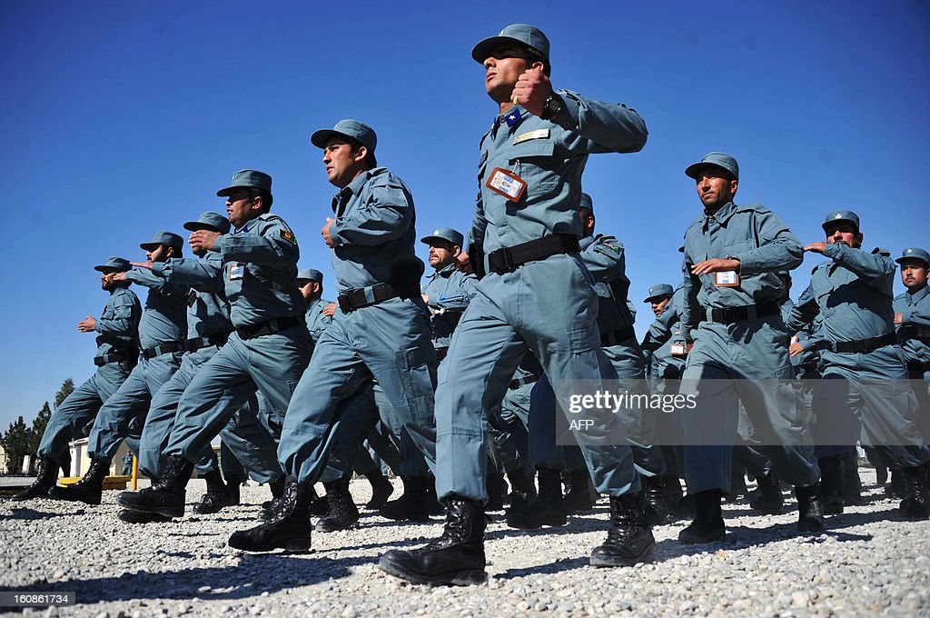 Afghan policemen march during a graduation ceremony at a police training centre in Jalalabad on February 7 , 2013. Over 200 police officers graduated after a sixteen-week course. Afghan forces, police and army, are due to take full security responsibility from their Western allies, a US-led NATO force, by the end of 2014 when the foreign troops leave the country. AFP PHOTO/ Noorullah Shirzada