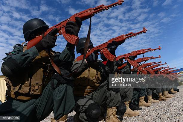 Afghan policemen perform a drill during exercises at a police training centre in Herat on January 27 2015 The conflict against the Taliban still...