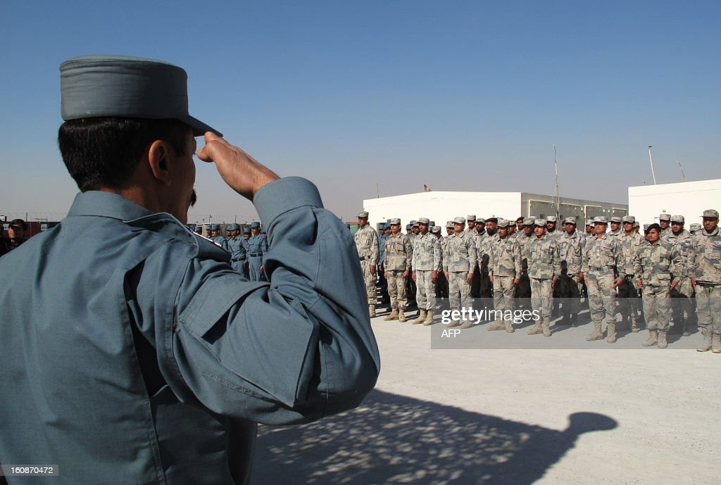 Afghan policemen stand at attention during a graduation ceremony at a police training centre in Helmand on February 7 , 2013. Over 200 police officers graduated after a sixteen-week course. Afghan forces, police and army, are due to take full security responsibility from their Western allies, a US-led NATO force, by the end of 2014 when the foreign troops leave the country. AFP PHOTO/ Noor Mohammad