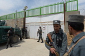 Afghan policemen stand guard at the gate of the Cure hospital in Kabul on April 24 2014 A guard shot dead three foreigners at a US charity hospital...