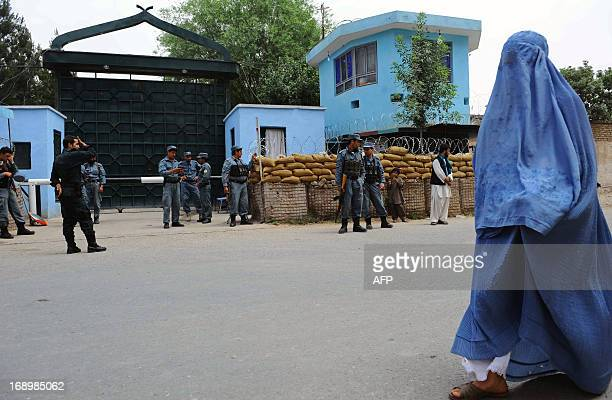 Afghan policemen stand guard at the gate of the main prison in Herat on May 18 2013 Two kidnappers convicted in the murder of an 11year old child...