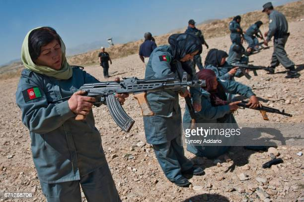 Afghan policewomen handle AMD65 rifles at a dusty firing range outside Kabul They are trained by carabinieri Italian military police from the local...