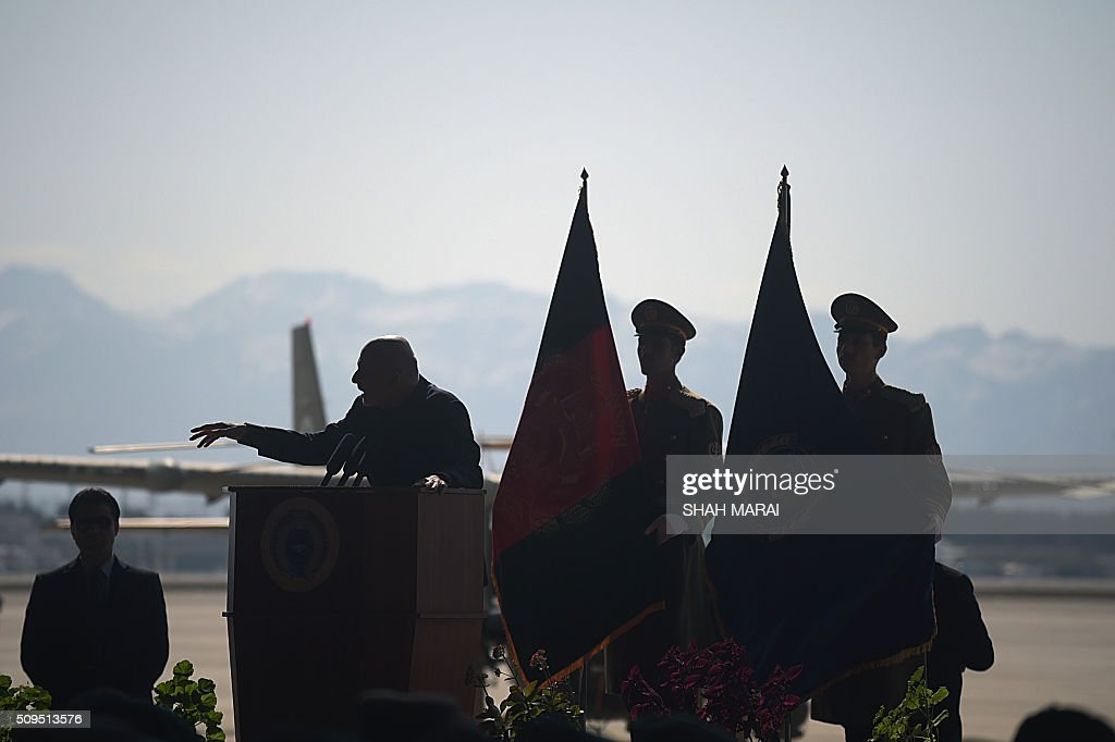 Afghan President Ashraf Ghani (2L) addresses an Afghanistan Air Force readiness performance program at a military airfield in Kabul on February 11, 2015. AFP PHOTO / SHAH Marai / AFP / SHAH MARAI