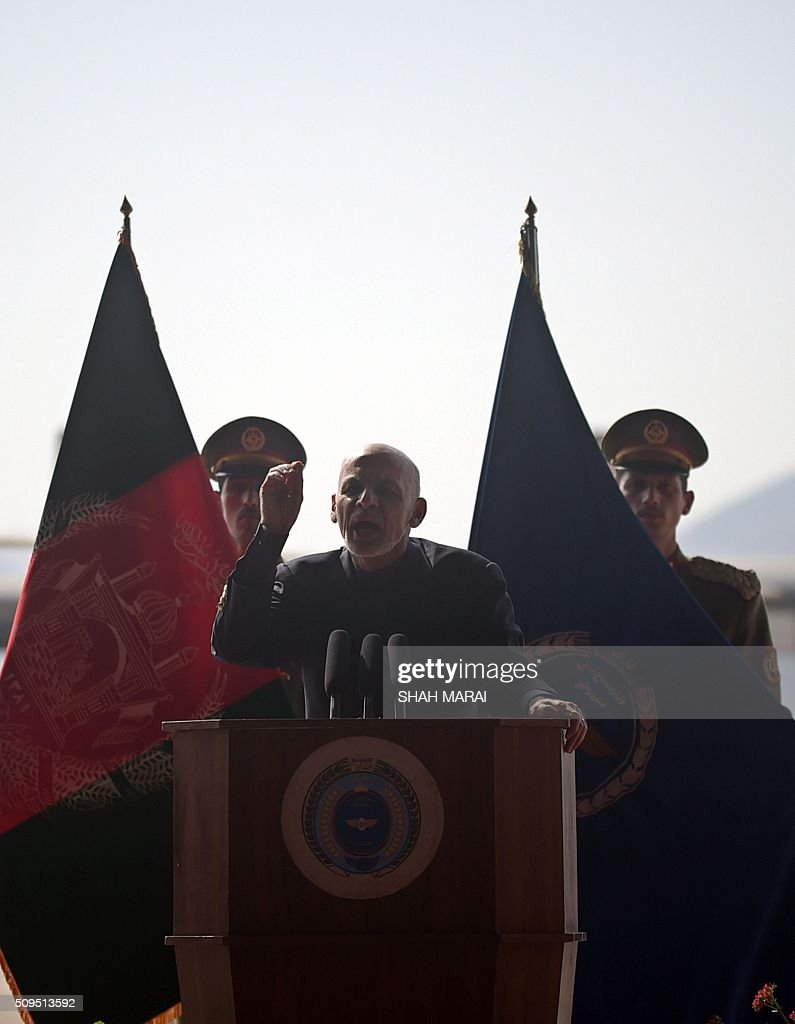 Afghan President Ashraf Ghani addresses an Afghanistan Air Force readiness performance program at a military airfield in Kabul on February 11, 2015. AFP PHOTO / SHAH Marai / AFP / SHAH MARAI