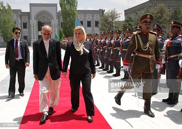 Afghan President Ashraf Ghani and his Croatian counterpart Kolinda GrabarKitarovic inspect the guard of honour at the Presidential Palace in Kabul on...