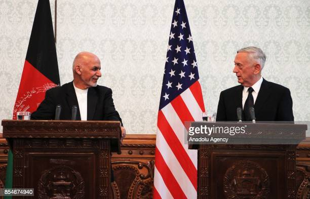 Afghan President Ashraf Ghani and US Defense Secretary James Mattis speak during a joint press conference in Kabul Afghanistan on September 27 2017