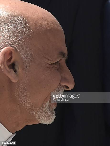 Afghan President Ashraf Ghani leaves after an international peace conference at the Presidential Palace in Kabul on June 6 2017 Afghan President...