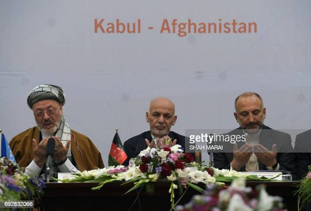 Afghan President Ashraf Ghani prays during an international peace conference at the Presidential Palace in Kabul on June 6 2017 Afghan President...
