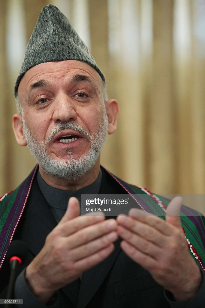 Afghan President <a gi-track='captionPersonalityLinkClicked' href=/galleries/search?phrase=Hamid+Karzai&family=editorial&specificpeople=121540 ng-click='$event.stopPropagation()'>Hamid Karzai</a> addresses a press conference at the Presidential Palace on November 3, 2009 in Kabul, Afghanistan. Re-elected Karzai promised his new government would stop corruption and engage with Taliban insurgents,