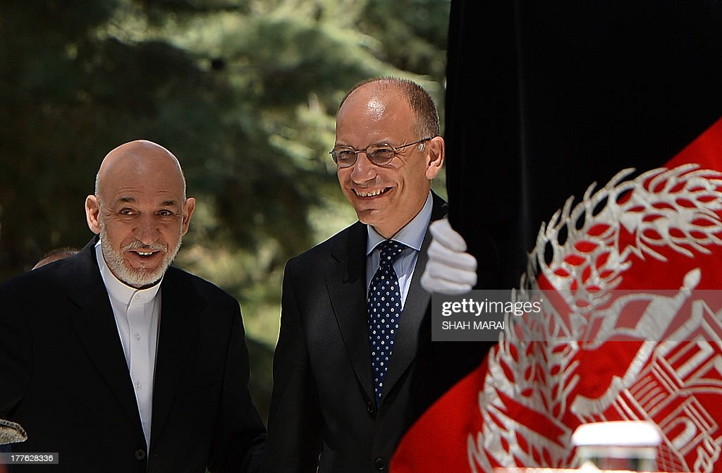 Afghan President Hamid Karzai (L) and Italian Prime Minister Enrico Letta walk to a joint press conference at the Presidential palace in Kabul on August 25, 2013. Letta visited the base of the Italian contingent in Herat on his arrival in the country - Italy has around 3,000 soldiers in Afghanistan as part of NATO's International Security Assistance Force (ISAF). AFP PHOTO/ SHAH Marai