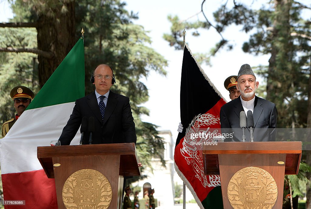 Afghan President Hamid Karzai (R) and Italian Prime Minister Enrico Letta listen to a question during a joint press conference at the Presidential palace in Kabul on August 25, 2013. Letta visited the base of the Italian contingent in Herat on his arrival in the country - Italy has around 3,000 soldiers in Afghanistan as part of NATO's International Security Assistance Force (ISAF). AFP PHOTO/ SHAH Marai