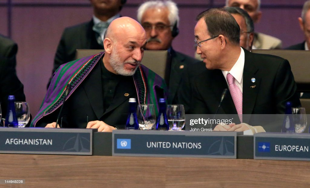 Afghan President Hamid Karzai (L) and UN Secretary General Ban Ki-moon speak during a meeting at the NATO summit on May 21, 2012 at McCormick Place in Chicago, Illinois. As sixty heads of state converge for the two day summit that will address the situation in Afghanistan among other global defense issues, thousands of demonstrators have taken the streets to protest.