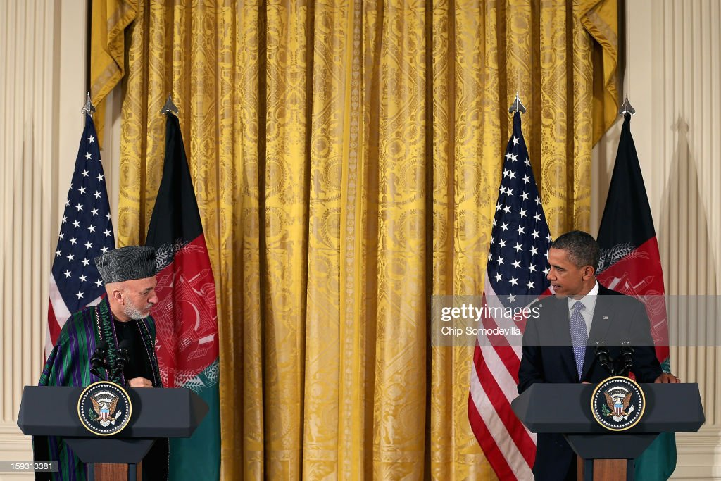 Afghan President <a gi-track='captionPersonalityLinkClicked' href=/galleries/search?phrase=Hamid+Karzai&family=editorial&specificpeople=121540 ng-click='$event.stopPropagation()'>Hamid Karzai</a> (L) and U.S. President <a gi-track='captionPersonalityLinkClicked' href=/galleries/search?phrase=Barack+Obama&family=editorial&specificpeople=203260 ng-click='$event.stopPropagation()'>Barack Obama</a> hold a joint news conference in the East Room of the White House January 11, 2013 in Washington, DC. Karzai is in Washington for face-to-face meetings with Obama and senior members of his administration about the future of American commitment to Afghanistan and when troops may leave the country after more than 10 years of war.