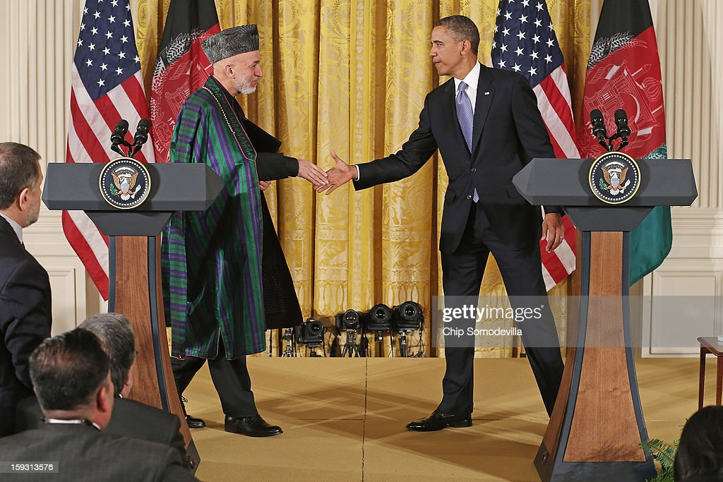 Afghan President Hamid Karzai and US President Barack Obama shake hands after holding a joint news conference in the East Room of the White House...
