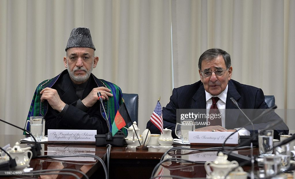 Afghan President Hamid Karzai (L) and US Secretary of Defense Leon Panetta hold a meeting at the Pentagon in Washington, DC, on January 10, 2013. AFP PHOTO/Jewel Samad