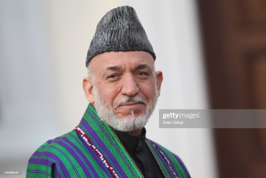 Afghan President <a gi-track='captionPersonalityLinkClicked' href=/galleries/search?phrase=Hamid+Karzai&family=editorial&specificpeople=121540 ng-click='$event.stopPropagation()'>Hamid Karzai</a> arrives at Bellevue Palace to meet with German President Christian Wulff on December 6, 2011 in Berlin, Germany. Karzai is in Berlin to meet with Wulff and German Chancellor Angela Merkel after he attended the international Afghanistan conference the day before in Bonn, during which he announced that Afghanistan will need another decade of financial support from international doners.