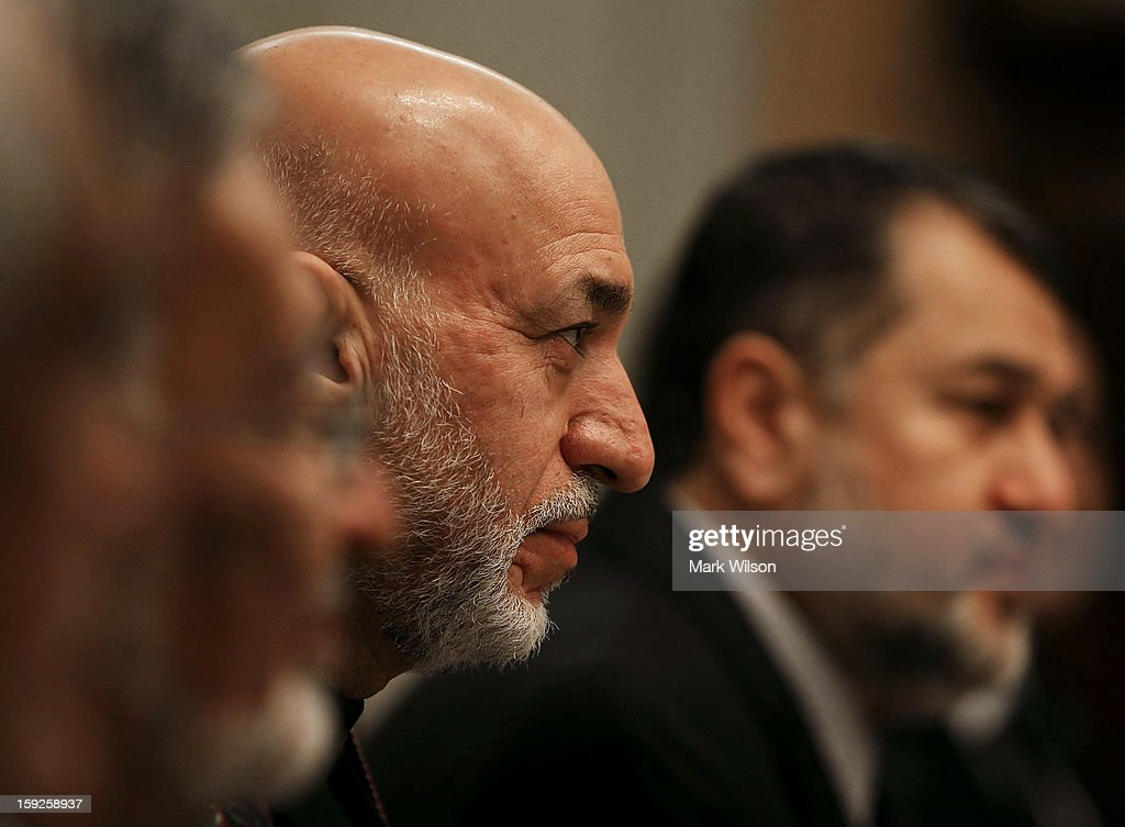 Afghan President Hamid Karzai attends a dinner hosted by Secretary of State Hillary Clinton at the State Department on January 10, 2013 in Washington, DC. Karzai is on a visit in Washington, including a meeting with U.S. President Barack Obama at the White House, to discuss the continued transition in Afghanistan and the partnership between the two nations.
