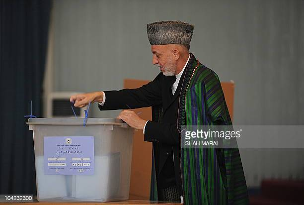 Afghan President Hamid Karzai casts his vote at a polling station in Kabul on September 18 2010 Karzai cast his vote in the country's parliamentary...