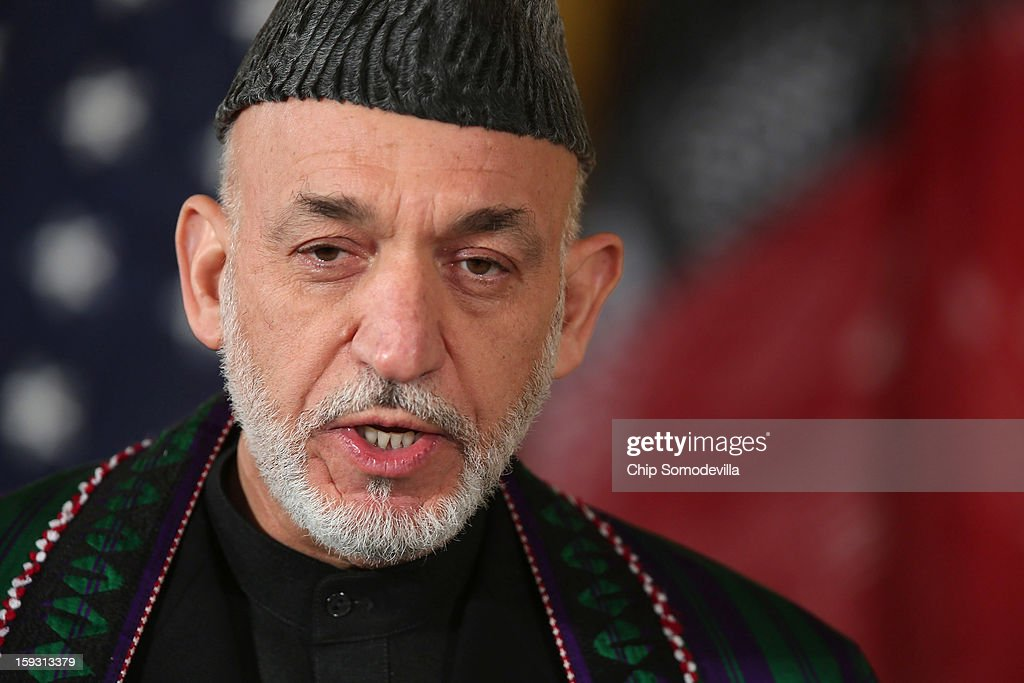 Afghan President Hamid Karzai delivers opening remarks during a joint news conference with U.S. President Barack Obama in the East Room of the White House January 11, 2013 in Washington, DC. Karzai is in Washington for face-to-face meetings with Obama and senior members of his administration about the future of American commitment to Afghanistan and when troops may leave the country after more than 10 years of war.