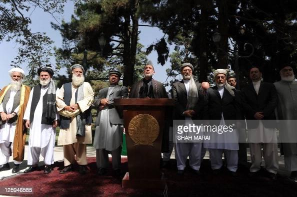 Afghan President Hamid Karzai flanked by vice Presidents Mohammad Qasim Fahim and Mohammed Karim Khalili former mujahidin leader Pir Sayed Ahmad...