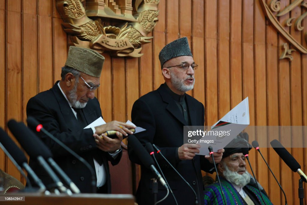 Afghan President <a gi-track='captionPersonalityLinkClicked' href=/galleries/search?phrase=Hamid+Karzai&family=editorial&specificpeople=121540 ng-click='$event.stopPropagation()'>Hamid Karzai</a> (C) gives the oath to members of the new parliament on January 26, 2011 Kabul, Afghanistan. Afghanistan's parliament was opened by President Karzai, ending a week-long stand-off with the newly elected MPs who had threatened to inaugurate the legislature with or without him. The ceremony, held in a National Assembly compound, comes four months after the country held its second post-Taliban parliamentary elections, the results of which have met with massive controversy over claims of widespread fraud.