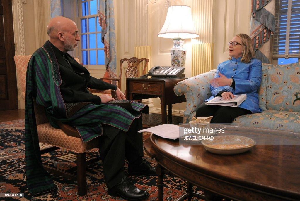 Afghan President Hamid Karzai (L) holds a meeting with US Secretary of State <a gi-track='captionPersonalityLinkClicked' href=/galleries/search?phrase=Hillary+Clinton&family=editorial&specificpeople=76480 ng-click='$event.stopPropagation()'>Hillary Clinton</a> at the State Department in Washington, DC, on January 10, 2013. US sought to assure Afghan President Hamid Karzai on Thursday that it would remain committed to his country even as US officials weigh a major withdrawal of American forces. AFP PHOTO/Jewel Samad