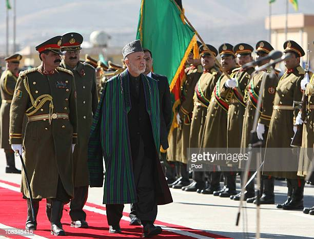 Afghan President Hamid Karzai inspects an honour guard before inaugurating the new National Assembly on January 26 2011 Kabul Afghanistan...
