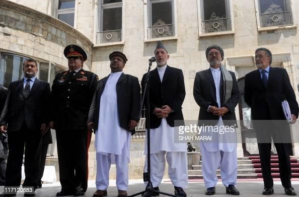 Afghan President Hamid Karzai is flanked by vice presidents Mohammad Qasim Fahim and Mohammed Karim Khalili Foreign Minister Zalmai Rasool Defence...