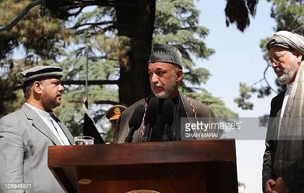 Afghan President Hamid Karzai is flanked by vice Presidents Mohammad Qasim Fahim and Mohammed Karim Khalili as he addresses media representatives...