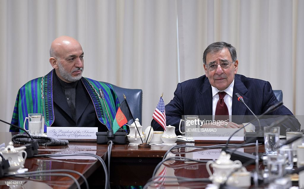 Afghan President Hamid Karzai (L) listens as US Secretary of Defense Leon Panetta speaks during their meeting at the Pentagon in Washington, DC, on January 10, 2013. AFP PHOTO/Jewel Samad