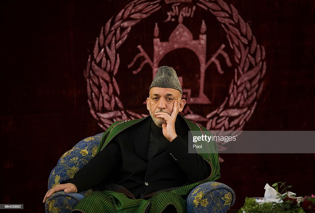 Afghan President Hamid Karzai listens during a meeting with elders on April 11 2010 in Kunduz Afghanistan President Karzai urged Taliban insurgents...