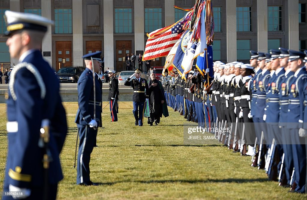 Afghan President Hamid Karzai (C) reviews a honor guard at the Pentagon before his meeting with US Secretary of Defense Leon Panetta in Washington, DC, on January 10, 2013. AFP PHOTO/Jewel Samad