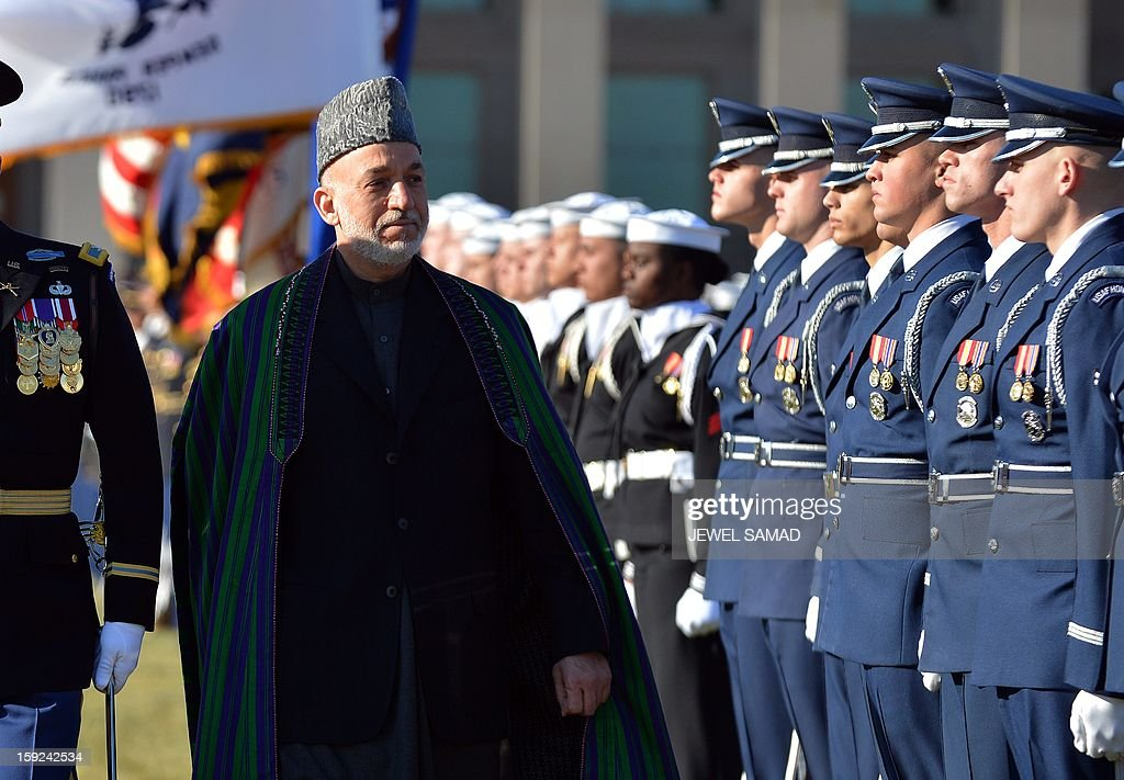 Afghan President Hamid Karzai reviews a honor guard at the Pentagon before his meeting with US Secretary of Defense Leon Panetta in Washington, DC, on January 10, 2013. AFP PHOTO/Jewel Samad