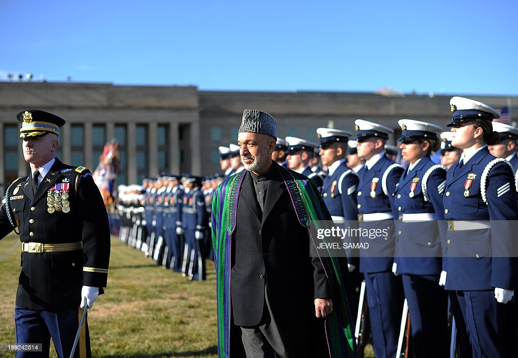 Afghan President Hamid Karzai reviews a honor guard before his meeting wiht US Secretary of Defense Leon Panetta at the Pentagon in Washington, DC, on January 10, 2013. AFP PHOTO/Jewel Samad