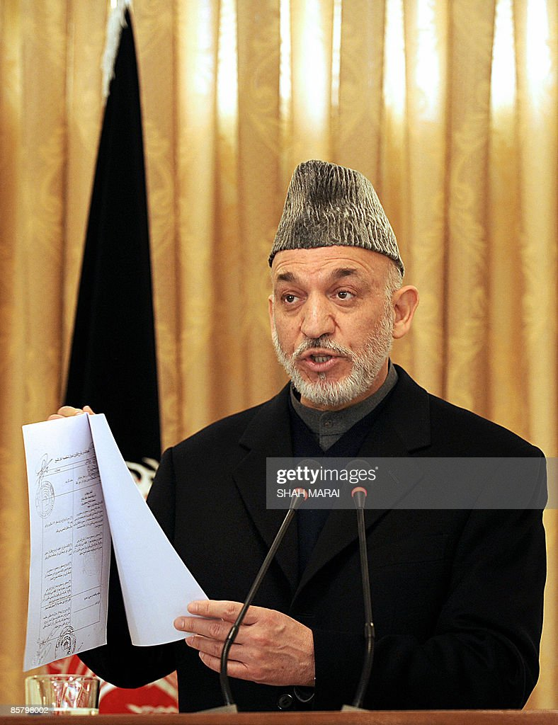 afghan president hamid karzai speaks as pictures getty images afghan president hamid karzai speaks as he holds a document during a press conference at the